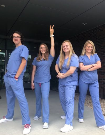 During the summer of 2018, I completed a Nurse Aide I training course and received my CNA certification. Here I am with my fellow classmates Frank Batts, Colleen Pecoraro and Caitlin Miller after clinicals in July 2018. This experience allowed me complete the year-long UNC Rex Healthcare College Program my junior year. During this program, I worked as a volunteer medical assistant in pre-operative planning.