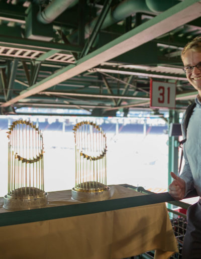 In October 2018, I traveled to Boston for the first time on our Fall Break: Boston trip. While there, I learned about professional development at MIT, Boston's rich history and the Red Sox's three recent World Series championships. Here I am next to the trophies at Fenway Park!